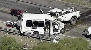 8 killed, more than dozen injured in head on collision between truck and passenger van