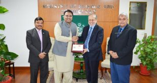 Federal Minister for S&T receives COMSATS' silver jubilee commemorative stamp