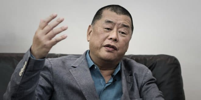 Jimmy Lai: Pro-democracy media tycoon arrested and charged