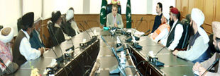 PM AJK urges Ullema to advise masses to offer daily and Friday prayers at home